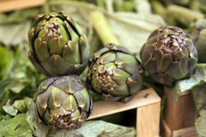 Artichokes in a box on a market counter